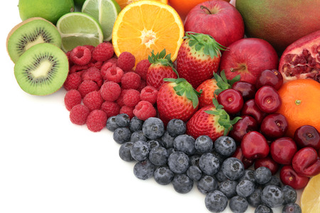 dietary fiber: Healthy mixed fresh fruit selection high in antioxidants, vitamin c and dietary fiber, with copy space. Stock Photo