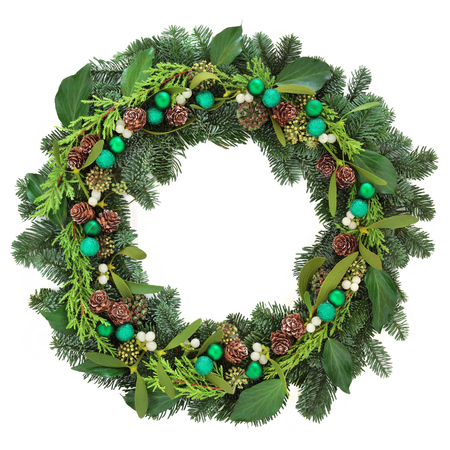 pine wreath: Christmas wreath with green bauble decorations, mistletoe, ivy, pine cones and blue spruce fir over white background.