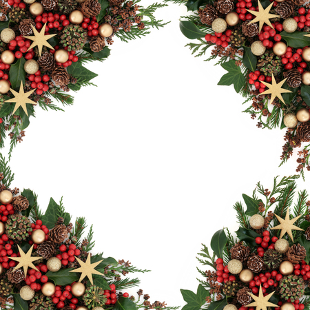 gold christmas decorations: Christmas background border with star and gold bauble decorations, holly, mistletoe, ivy and winter greenery over white.