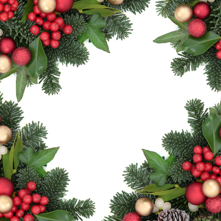 ball: Christmas background border with red and gold bauble decorations, holly, ivy, mistletoe, snow covered pine cones and blue spruce fir over white. Stock Photo