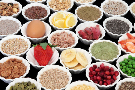super fruit: Health and body building high protein super food of meat, fish and dairy, with supplement powders, seeds, cereals, grains, fruit and vegetables.