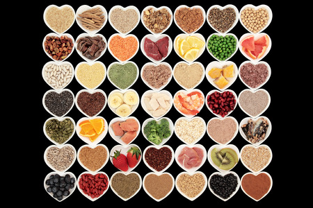 fresh meat: Large body building high protein health food of meat and fish with supplement powders, grains, cereals, seeds, pulses, fruit and vegetables. Stock Photo