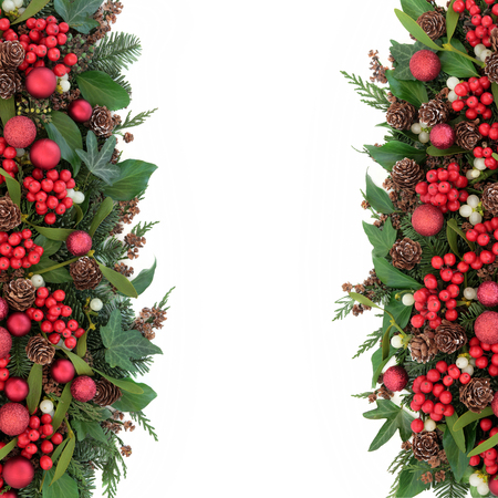 christmas ivy: Christmas background border with red bauble decorations, holly, mistletoe, ivy, fir, pine cones and traditional winter greenery over white. Stock Photo