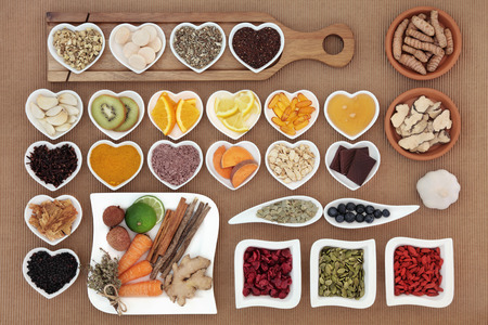 cold remedy: Large health food selection for cold cure remedy with vitamin c supplement capsules and medicinal herbs and spices, high in antioxidants. Stock Photo