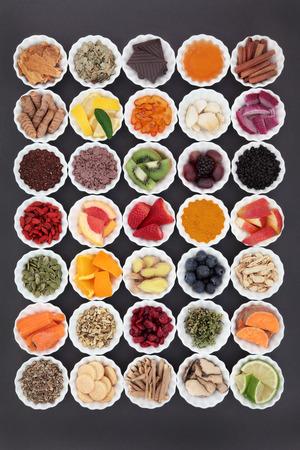 cold cure: Large food and medicinal herb selection for cold and flu cure with foods high in antioxidants and vitamin c including supplement capsules. Stock Photo