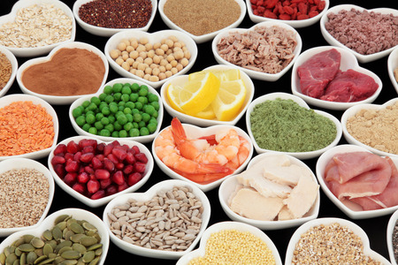super fruit: Health and body building high protein super food of meat, fish, with supplement powders, seeds, cereals, grains, fruit and vegetables. Selective focus.