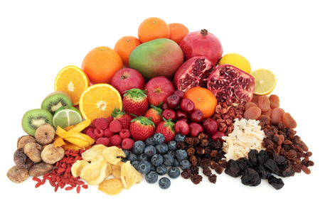 superfood: Large superfood fresh fruit selection over white background.