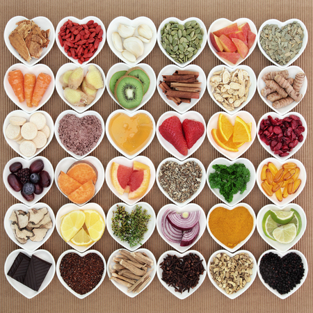 antioxidants: Large super food and medicinal herb selection for cold and flu remedy with foods high in antioxidants and vitamin c with supplement capsules. Stock Photo