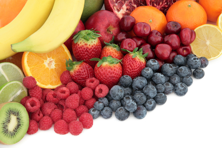 antioxidants: Fresh mixed fruit superfood background selection with fruits high in antioxidants, vitamin c and dietary fibre with copy space. Stock Photo