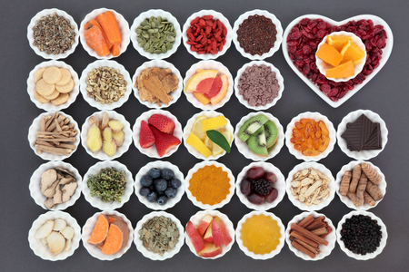 cold cure: Cold cure and flu remedy food with health foods high in antioxidants and vitamin c with supplement capsules and medicinal herbs. Stock Photo