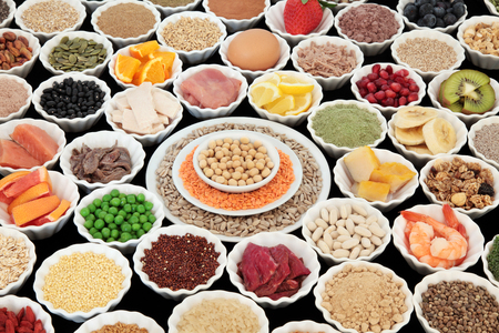 pulses: Large health and body building high protein super food of meat, fish, dairy, pulses, cereals, grains, seeds, supplement powders, fruit, vegetable  selection. Selective focus.