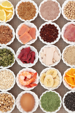 super fruit: Health and body building high protein super food of meat, fish, dairy, supplement  powders, seeds, pulses,   nuts, fruit, vegetable and herb selection.