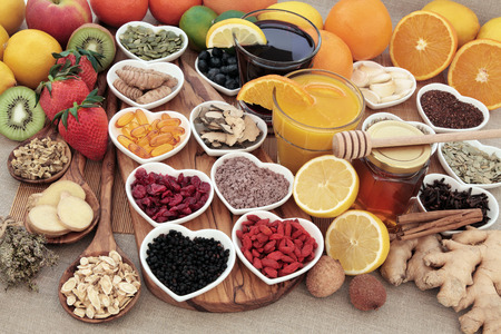 super fruit: Healthy super food for cold remedy with fruit, orange and blackcurrant drinks, vitamin c supplement capsules, honey and medicinal herbs and spices, high in antioxidants.