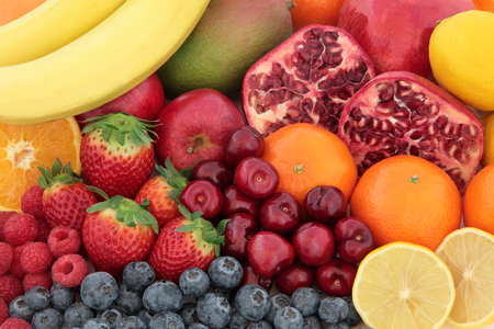 vitamin c: Fresh mixed fruit superfood background with fruits high in antioxidants, vitamin c and dietary fibre.