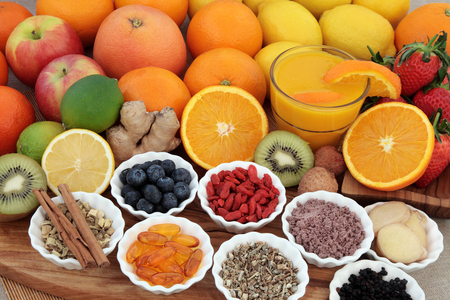 cold cure: Large super food fruit selection with herbs, spices and supplement capsules for cold and flu remedy including foods high in antioxidants and vitamin c. Stock Photo