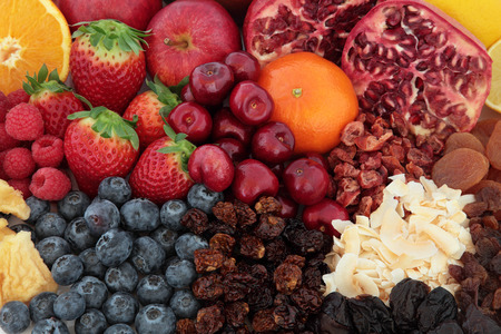 superfood: Superfood fruit selection forming a background, high in antioxidants, vitamins and dietary fibre background. Stock Photo