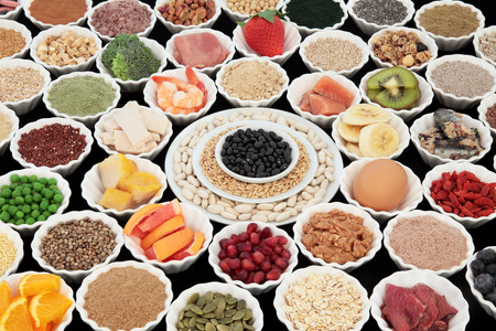 super fruit: Large health and body building protein super food with high nutritional values including meat, fish, dairy, pulses, cereals, grains, seeds, supplement powders, fruit and vegetables. Selective focus.