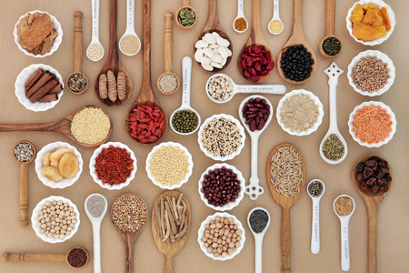 dietary fiber: Large superfood sampler for good health in spoons and bowl forming an abstract background. Highly nutritious in antioxidants, vitamins, minerals and dietary fiber.