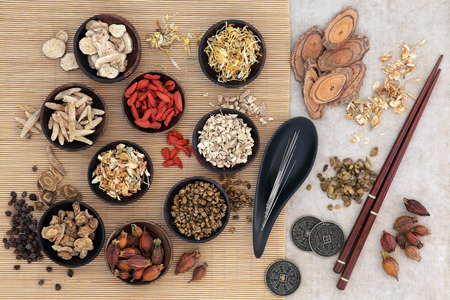chinese herbs: Acupuncture needles, traditional chinese herbs for herbal medicine, i ching coins and chopsticks. Stock Photo