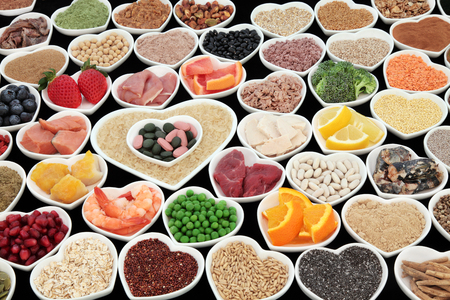 pulses: Large body building and health high protein super food with meat, fish, dairy, pulses, cereals, grains, seeds, supplement powders, vitamin pills, fruit and vegetable  selection. Selective focus,