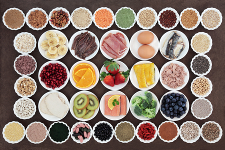 super fruit: Large health and body building high protein super food of meat, fish and dairy, with supplement powders, vitamin pills, cereals, grains, fruit and vegetables. Stock Photo