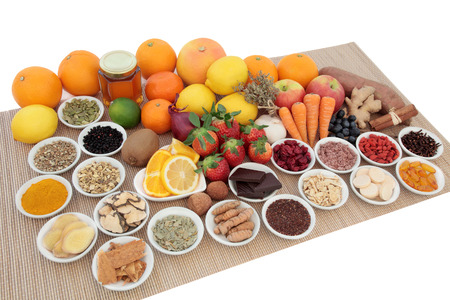 cold cure: Health food and natural herbal medicine selection for cold and flu remedy including foods high in antioxidants and vitamin c on bamboo over white background.