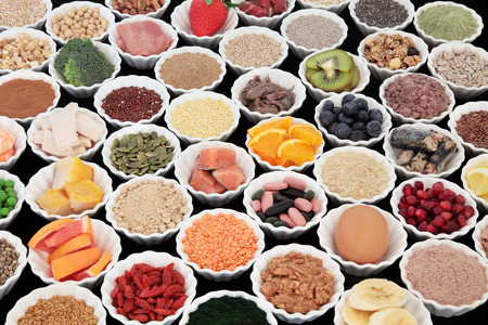 super fruit: Large health and body building protein super food with high nutritional values including meat, fish, dairy, pulses, cereals, grains, seeds, supplement powders, vitamin pills, fruit and vegetables.