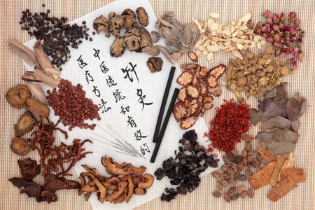 moxa: Chinese medicinal herb ingredients, acupuncture needles and moxa sticks  with calligraphy on rice paper. Translation describes acupuncture chinese medicine as a traditional and effective medical solution. Stock Photo