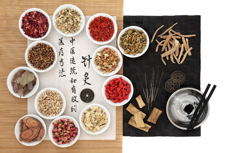 describes: Chinese herbs, acupuncture needles, moxa sticks and i ching coins with calligraphy on rice paper. Translation describes acupuncture chinese medicine as a traditional and effective medical solution.