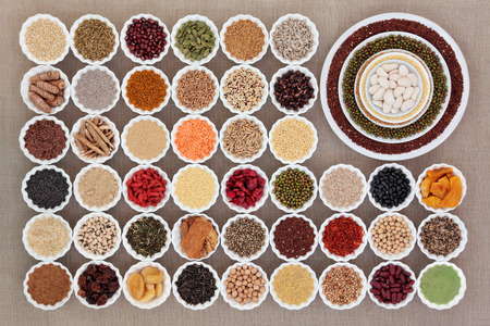 large bean: Large dried health food sampler in china bowls forming an abstract background over hessian. High in antioxidants, vitamins, minerals and dietary fibre.