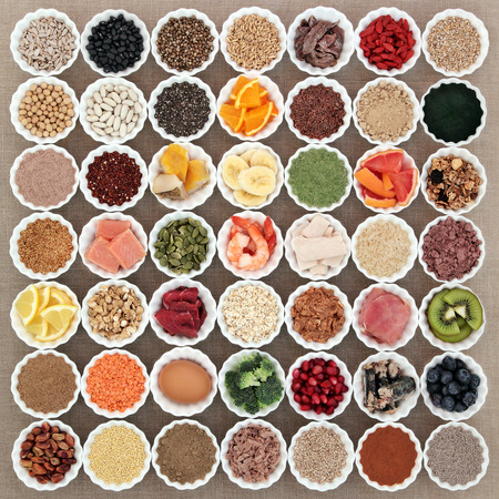 super fruit: Large health and body building high protein super food of meat, fish, dairy, supplement powders, grain, cereals, seeds, fruit and vegetable selection.