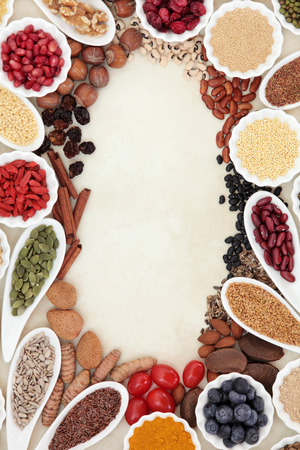 super food: Super food border in porcelain dishes over parchment paper background. High in vitamins and antioxidants.
