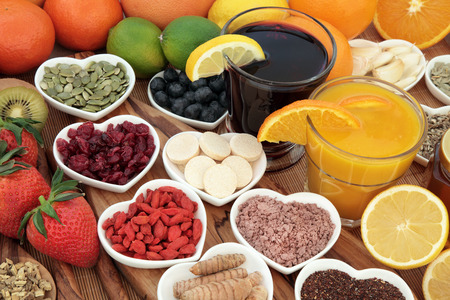 immune system: Health food for cold cure with fruit, orange and blackcurrant drinks high in antioxidants and vitamin c with supplement capsules and medicinal herbs.