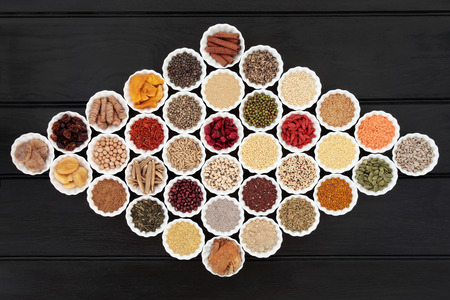 dried food: Large dried health food sampler in china bowls forming an abstract background. High in antioxidants, minerals, vitamins and dietary fiber.