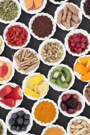 cold cure: Super food and medicinal herb selection for cold and flu remedy including foods high in antioxidants and vitamin c over grey background. Stock Photo