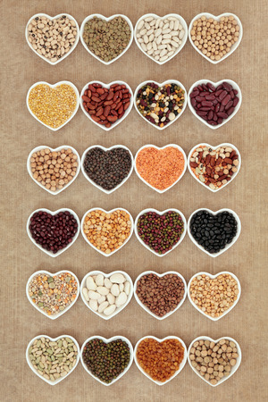 pulses: Dried vegetable pulses selection in heart shaped porcelain china dishes.