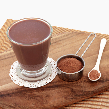 maca root: Chocolate maca health drink and supplement powder in a metal scoop. Used as an aphrodisiac and also by body builders and in weight training.