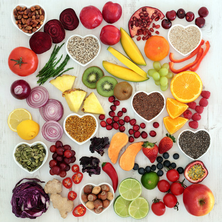 Paleolithic diet health and superfood of fruit, vegetables, nuts and seeds on distressed white wooden background, high in vitamins, anthocyanin, antioxidants, dietary fiber and minerals. Archivio Fotografico