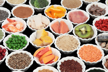 pulses: Body building high protein health food of meat and fish with supplement powders, grains, seeds, pulses, fruit and vegetables. Selective focus.