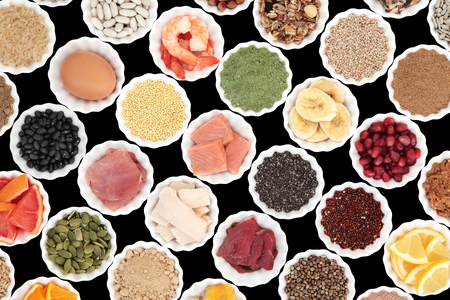 super fruit: Health and body building high protein super food of meat, fish, dairy, supplement powders, grains, cereals, pulses, seeds, fruit and vegetable selection.
