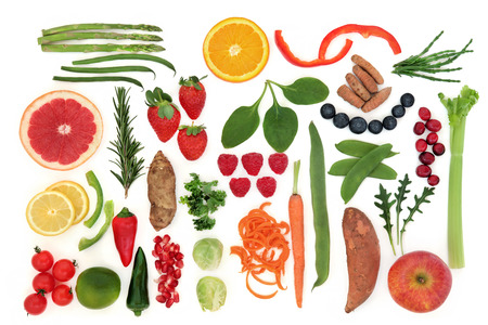 paleolithic: Paleolithic diet health food of fruit and vegetables over white background. High in vitamins, antioxidants, minerals and anthocyanins.