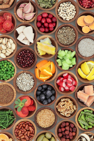 super food: Super food diet selection in wooden bowls. High in antioxidants, vitamins, minerals and anthocyanins.
