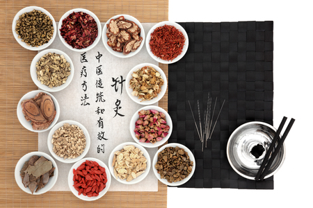 moxibustion: Traditional chinese medicinal herb ingredients, acupuncture needles and moxa sticks, with calligraphy on rice paper. Translation describes acupuncture chinese medicine as a traditional and effective medical solution.