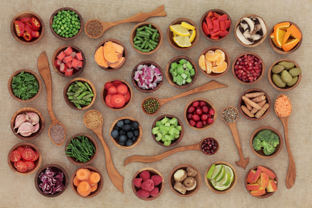 selection: Healthy diet food selection in wooden bowls and spoons. High in antioxidants, vitamins, minerals and anthocyanins.