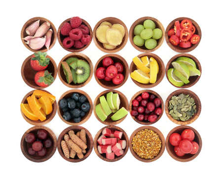 super food: Health super food selection for cold and flu remedy high in antioxidants, anthocyanins  and vitamins in wooden bowls over white background. Stock Photo