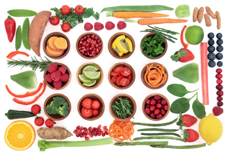 super fruit: Health and super food selection for paleo diet with fruit and vegetables over white background. High in vitamins, antioxidants, minerals and anthocyanins. Stock Photo