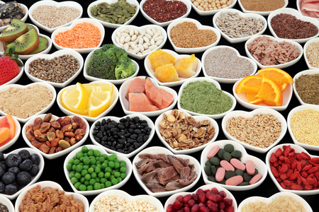 super food: Large health and body building protein super food with high nutritional values including meat, fish, pulses, cereals, grains, seeds, supplement powders, fruit and vegetables. Stock Photo