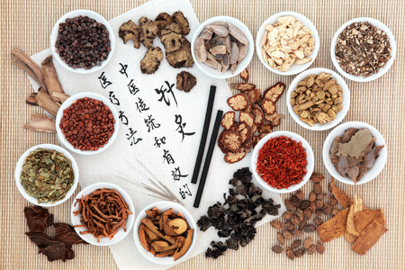 describes: Chinese herb ingredients, acupuncture needles and moxa sticks, with calligraphy on rice paper. Translation describes acupuncture chinese medicine as a traditional and effective medical solution. Stock Photo