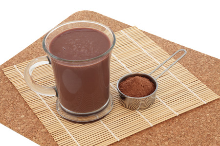 aphrodisiac: Chocolate maca health drink and supplement powder in a metal scoop. Used as an aphrodisiac and also by body builders and in weight training.