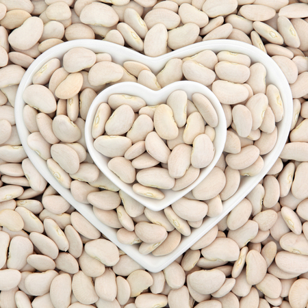 lima bean: Lima bean super food in heart shaped bowls forming an abstract background. Stock Photo